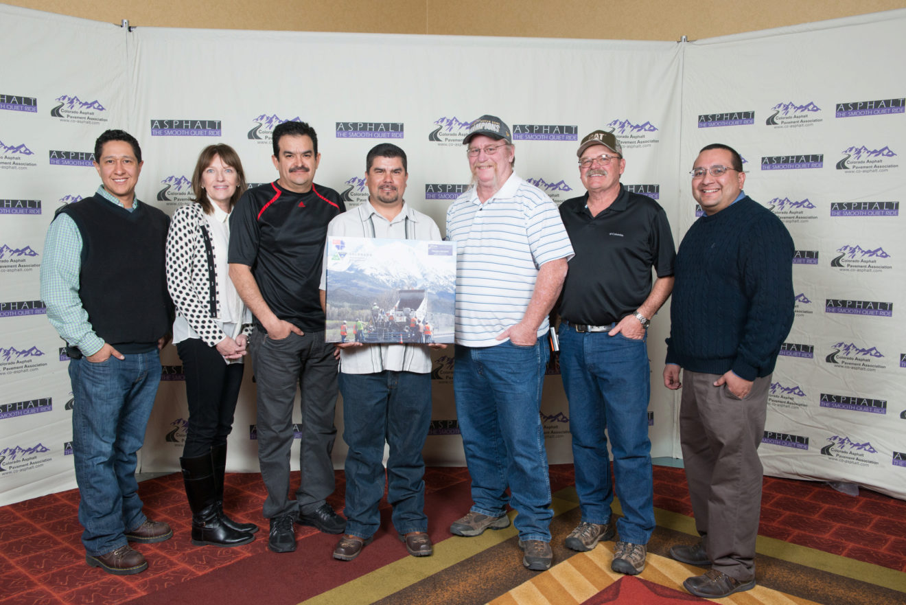 "22nd Annual ""Best in Colorado"" Asphalt Pavement Awards, the State Highway 133, Redstone North-South won Best in Colorado first place in the Project Delivery category. Members of the crew pose in front of a backdrop at the awards."