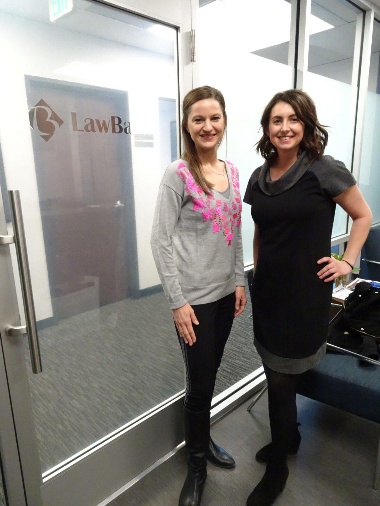 Photo of team members Heather and Megan standing at LawBank
