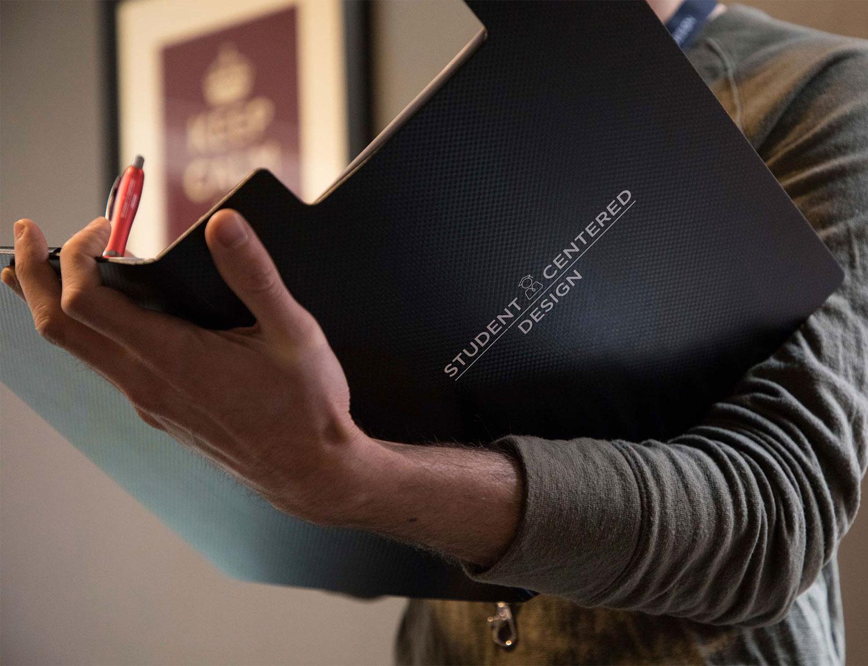 Photo of man using our custom designed Job Corps Student Centered Design folder