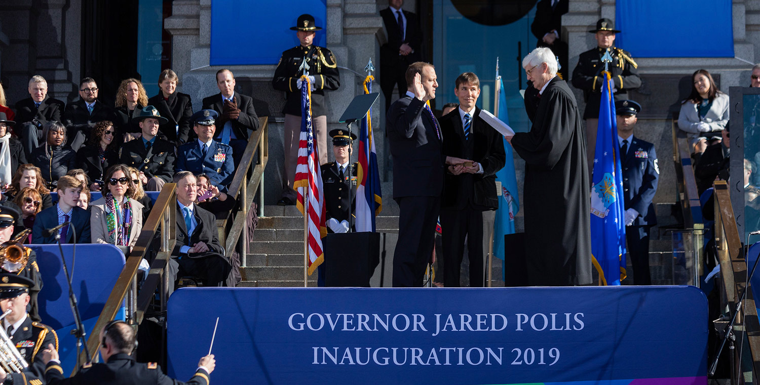 Governor Jared Polis being sworn into office in front of the Denver capitol
